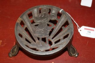 A 20th century steel trivet of circular form decorated with the early Walt Disney cartoon