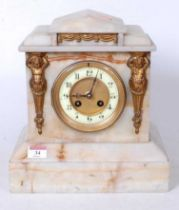 A late Victorian alabaster cased mantel clock, of architectural form with Egyptian revival type gilt
