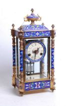 A reproduction gilt brass and enamel four glass mantel clock, having an unsigned polychrome