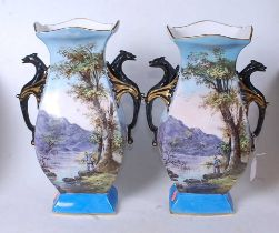 A pair of early 20th century vases, of shaped rectangular form, each decorated with a lone fisherman