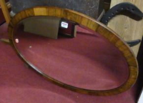 An early 20th century rosewood framed and bevelled oval wall mirror, 80x56cm