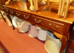 A reproduction mahogany three drawer console table, raised on cabriole supports, width 169cm