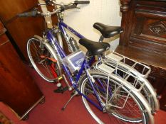 A Raleigh Pioneer 160 gent's bicycle; together with a matching lady's example, with two pumps and