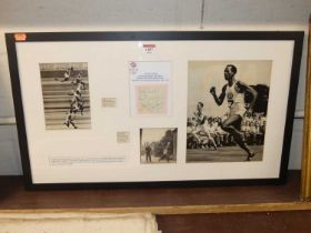 A framed display of cuttings commemorating British athlete McDonald Bailey's achievement in