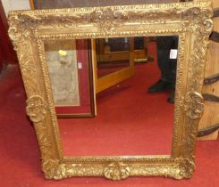 A 19th century gilt composition picture frame with later inset mirrorplate, full dimensions 67 x