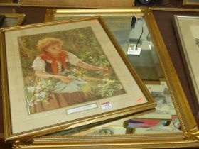 A reproduction gilt framed and bevelled wall mirror, 73 x 50cm; and a Sophie Anderson reproduction