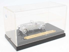 Dinky Toys Special Code 3, 22a Sports Car in silver and comes in a rigid perspex display case with a
