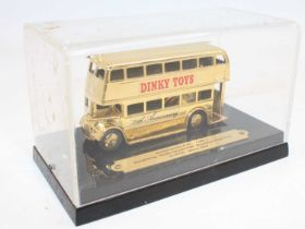 """Dinky Toys Special Code 3, of the 29c Double Decker bus in """"Dinky Toys"""" livery, finished in gold"""