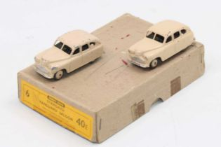 Dinky Toys 40e original Trade of Standard Vanguard Saloons containing two in cream colour with