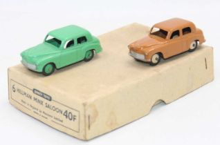 Dinky Toys 40f original Trade box containing 2 Hillman Minx, one in green and one in butterscotch