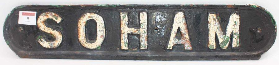 "Original cast-iron railway bench seat back sign, ""Soham"", white on black example, a rare example"