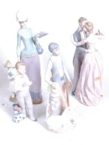 A Lladro Spanish porcelain figure group of a mother and child, h.36cm; together with three other