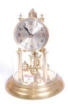 A 20th century Schatz brass anniversary clock, the silvered dial showing Arabic numerals, h.30cm,
