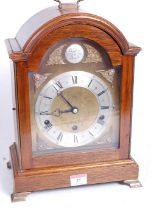 A 20th century mahogany cased bracket clock, in the Georgian style, the eight-day movement with