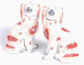 A pair of Staffordshire pottery models of seated spaniels, each h.24cmCondition report: Restored.