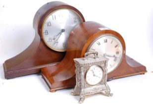 An early 20th century walnut cased Napoleon's hat eight-day mantel clock, with chimes, the
