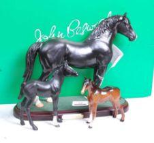 A John Beswick of Royal Doulton model of a Welsh Cob Stallion, mounted on a plinth, h.24cm, boxed;