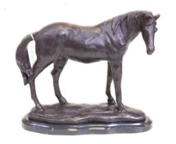 A bronze model of a horse, shown in standing pose, mounted upon a veined black marble plinth, h.23cm