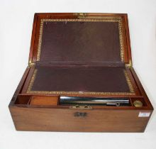 A Victorian mahogany cased writing slope, the lid with brass cartouche opening to reveal a gilt