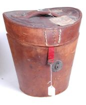 A Victorian tan leather top-hat box, with fitted red silk interior, h.34cm