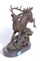 A bronze model of a running stag, upon a naturalistic base, mounted upon a slate plinth, h.