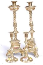 A pair of Victorian brass table candlesticks, each of baluster form, standing on a circular foot,