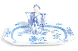 An 18th century Chinese blue and white glazed octagonal dish, with floral decoration within a diaper