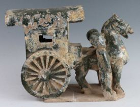 A Chinese green glazed terracotta Mingqi cart, with a single horse flanked by attendants, probably