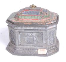 A 19th century pewter tobacco box, the lid with polychromatic decoration, the octagonal body