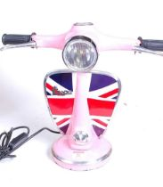 A modern pink painted desk lamp in the form of a Vespa moped, h.33cm