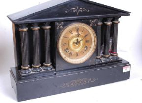 A Victorian black slate mantel clock, of architectural form, the gilt chapter ring showing Roman