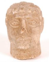 A marble portrait head, carved as a Roman male, 1st/2nd century style, h.13cm.Condition report: