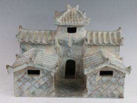 A Chinese green/blue glazed pottery model of a temple, having two tiers each with corrugated style