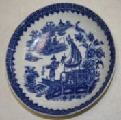 An 18th century Worcester porcelain bowl underglaze blue decorated with a Chinese figure on a junk
