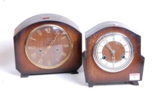 A 1930s oak cased eight-day mantel clock, the chapter ring showing Roman numerals, h.19cm;