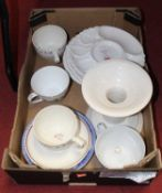 A box containing a collection of various ceramics, to include asparagus dishes, a large candlestick,