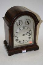 An early 20th century mahogany cased bracket clock, the arched dial with subsidiary speed and