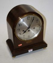 An early 20th century mahogany and boxwood strung mantel clock, the eight day movement with