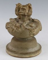 A Chinese pottery vase, the body modelled as two kylin to the shoulder with the heads and the