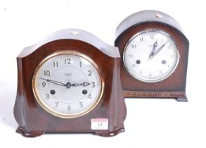 A 1930s bakelite cased eight-day mantel clock, the silvered dial showing Arabic numerals and