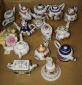 A collection of 20th century miniature porcelain teapots