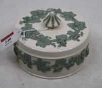 A Wedgwood embossed Queensware trinket dish and cover of circular form, relief decorated with