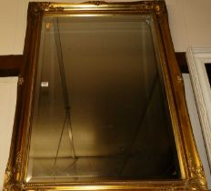 Reproduction gilt framed and bevelled rectangular wall mirror, 104x74cm