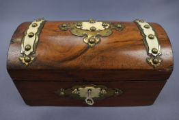 A Victorian walnut two compartment tea caddy decorated with gilt brass strapwork