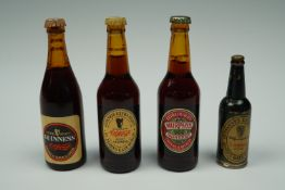 Three Miniature Guinness bottles and one other