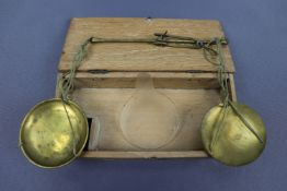 A cased set of 19th Century beam scales and weights