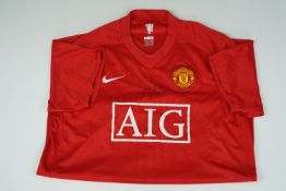 A signed Manchester United player's shirt, that of Quinton Fortune and signed at the Stretford