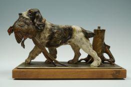 An Austrian cold-painted table lighter modelled as hound retrieving a pheasant, circa 1930s, 25 cm x