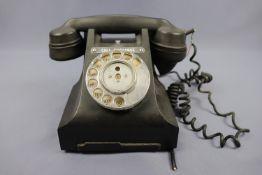 A vintage black Bakelite telephone