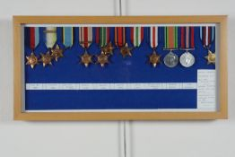 A framed collection of Second World War British campaign medals, including a reproduction Air Crew
